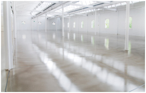 Drying a polished concrete floor
