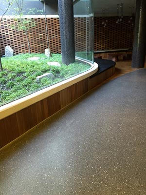 green building with polished concrete floor