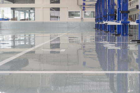 epoxy flooring in a car workshop